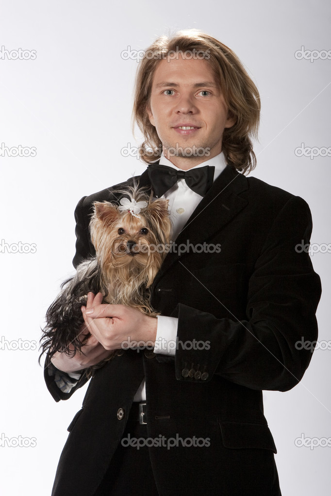 Portrait of two, gentleman holding his dog, a cute yorkshire terrier, studio image  Stock Photo #3902131