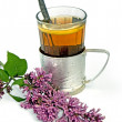 Постер, плакат: Tea in a glass with lilac