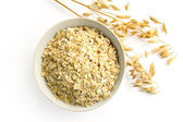 Oat flakes and oat stems — Stock Photo