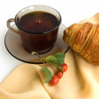 Brown cup of tea and croissants — Zdjęcie stockowe