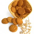 Oatmeal cookies spilled from the basket — Stockfoto