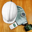 Stock Photo: White helmet, gas mask and dosimeter