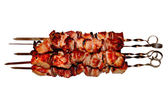 Pork kebab on white plate — Stock Photo