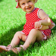 Stock Photo: Happy little girl on lawn