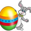 Easter bunny with colorful egg — Stock Photo