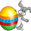 Easter bunny with colorful egg - Stock Photo