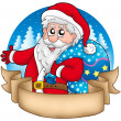 Banner with Santa holding gifts — Stock Photo