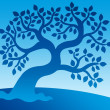 Blue leafy tree - Stock Photo