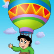 Boy in balloon on sky - Stock Photo