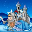 Castle and knight in winter landscape - Stock Photo