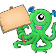 Stock Photo: Cute monster with wooden sign