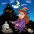 Cute witch on broom with mansion - Stock Photo