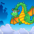 Flying green dragon with castle — Stock Photo