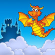 Red dragon with castle - Stock Photo