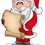 Santa reading parchment on iceberg — Stock Photo #2942385