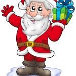 Santa with Christmas gift on iceberg — Stock Photo #2942389