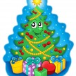 Smiling Christmas tree with gifts on sky — Stockfoto