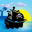 Sunset with pirate ship silhouette — Stock Photo