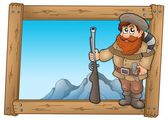 Cartoon trapper in wooden frame — Stock Photo