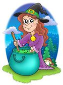 Cute witch with kettle — Stock Photo