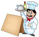 šéfkuchař drží jídlo s dřevěný stůl — Stock fotografie