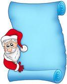 Christmas blue scroll with Santa 1 — Stock Photo