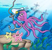 Polpo con ancoraggio e stelle marine — Foto Stock