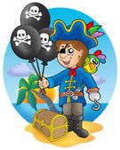 Pirate boy with balloons on beach — Stock Photo