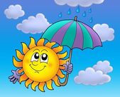 Soleil avec umbrela sur ciel nuageux — Photo