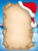 Winter parchment with Santas hat — Stock Photo
