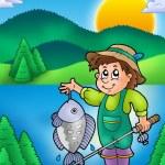 Small fisherman with fish — Stock Photo