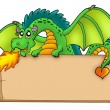 Giant green dragon holding board — Stock Photo