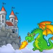Green dragon with castle on hill — Stock Photo