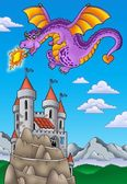Flying dragon with castle on hill — Stock Photo