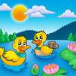 Two ducks and water lillies - Stock Photo