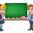 Girl and boy with old chalkboard — Stock Photo