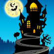 Stock Photo: Haunted house on hill with Moon