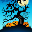 Spooky tree with bats and pumpkins — Stock Photo