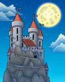 Night view on castle on rock — Stock Photo