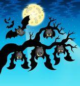 Cartoon bats with full moon — Stock Photo