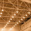 Yellow interior warehouse lighting — Stockfoto