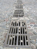Sewerage on stone road, metallic — Stock Photo