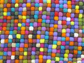 Alfombra de seda turca tela colorida, diversidad de ropa. — Foto de Stock