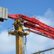 Industrial red crane, construction site — Stock Photo