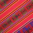 Mexican colorful fabric silk shawl texture, colors — Stock Photo #3371888