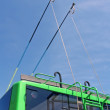 Green trolleybus bars on blue sky, transportation - Stock Photo