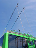 Green trolleybus bars on blue sky, transportation — Stock Photo