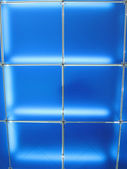 Abstract blue glass construction, square frames lighting — Stock Photo