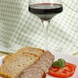 Sausage and glass of wine — Photo #3112063