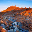 Black mountain peak on sunset - Stock Photo